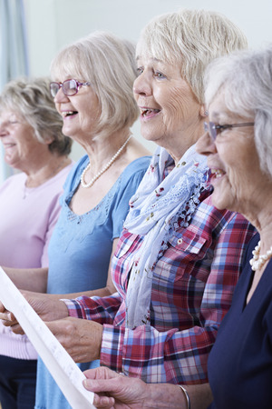 hymn: Group Of Senior Women Singing In Choir Together