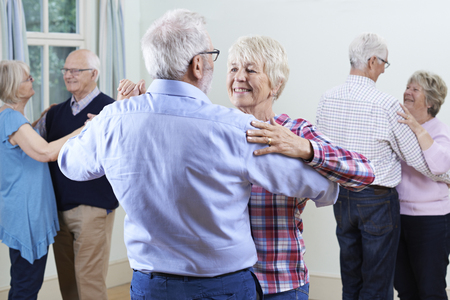 Group Of Seniors Enjoying Dancing Club Together Stock Photo - 63034794