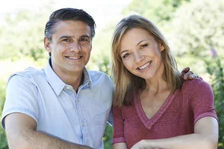 natural looking: Outdoor Head And Shoulders Portrait Of Smiling Mature Couple