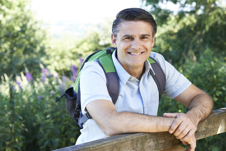 fourties: Portrait Of Mature Man Hiking In Countryside