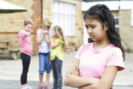Unhappy Girl Being Gossiped About By School Friends