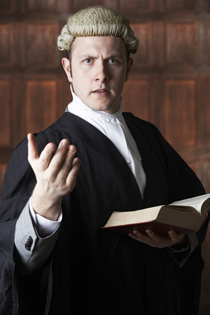 libel: Portrait Of Lawyer Holding Brief And Book Making Speech