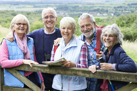 Group Of Senior Friends Hiking In Countryside Archivio Fotografico
