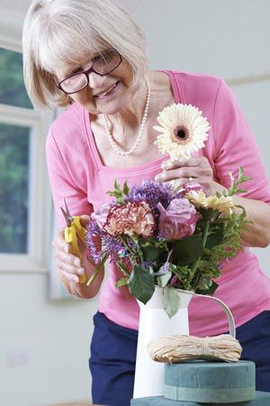 arranging: Senior Woman In Flower Arranging Class