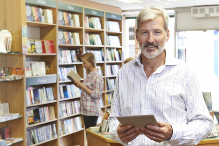 Portrait Of Male Booshop Owner Using Digital Tablet Stock Photo - 65622064