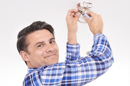 replacing: Man Replacing Battery In Home Smoke Alarm