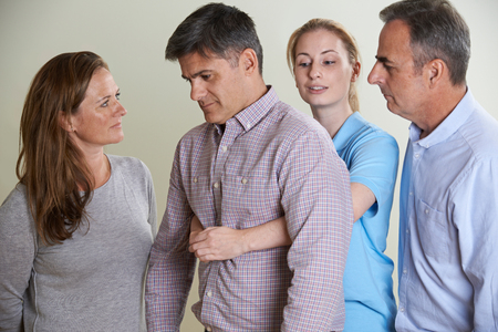 Woman Demonstrating Heimlich Maneuver In First Aid Class