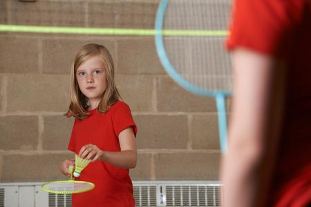 school gym: Two Girls Playing Badminton In School Gym