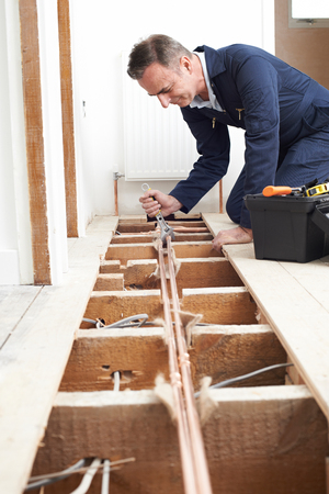 fitting in: Plumber Fitting Central Heating System In House