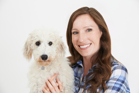lurcher: Studio Shot Of Woman With Pet Lurcher Dog Stock Photo