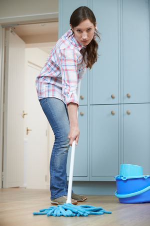 Unhappy Woman Cleaning Kitchen Floor With Mop Stock Photo, Picture ...
