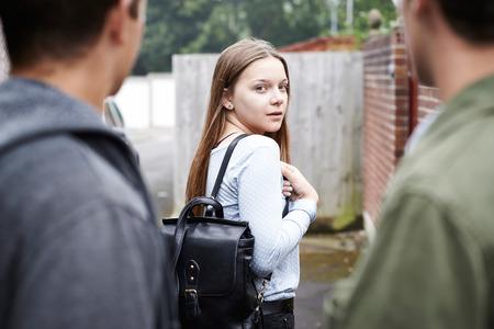 intimidated: Teenage Girl Feeling Intimidated As She Walks Home