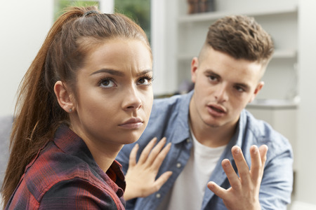reluctant: Teenage Couple Having Relationship Difficulties Stock Photo