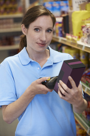 hand held: Sales Assistant Checking Stock Levels In Supmarket Using Hand Held Device Stock Photo