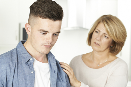 Mother Worried About Unhappy Teenage Son Archivio Fotografico
