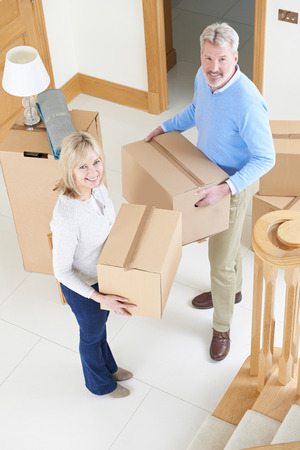 property ladder: Mature Couple Moving In To New Home  Stock Photo