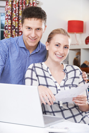 home finances: Couple Discussing Domestic Finances At Home Stock Photo