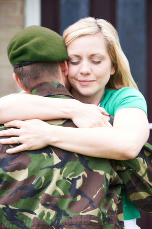 homecoming: Wife Hugging Army Husband Home On Leave