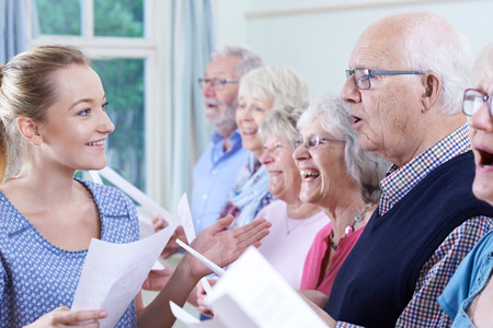 hymn: Group Of Seniors With Teacher Singing In Choir Together Stock Photo
