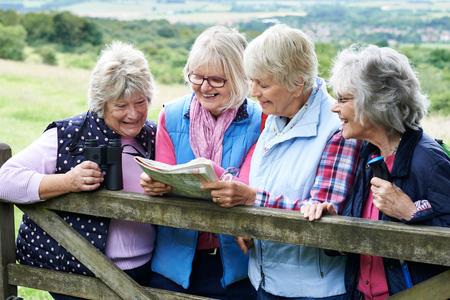 elderly people: Group Of Senior Female Friends Hiking In Countryside
