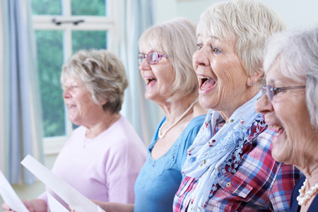 church people: Group Of Senior Women Singing In Choir Together