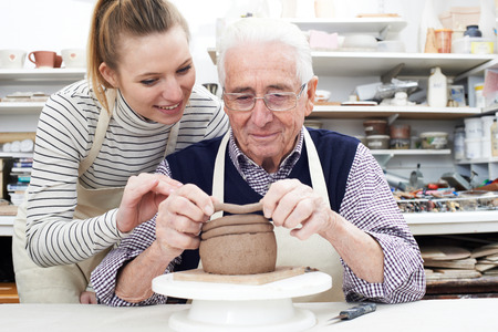 pottery: Senior Man With Teacher In Pottery Class Stock Photo
