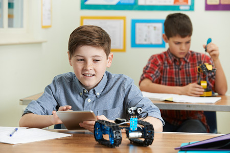 Pupils In Science Lesson Studying Robotics Standard-Bild