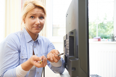 cable tv: Confused Woman Unsure As to How To Put Leads Into New Television