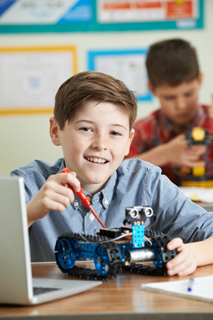 science lesson: Two Male Pupils In Science Lesson Studying Robotics