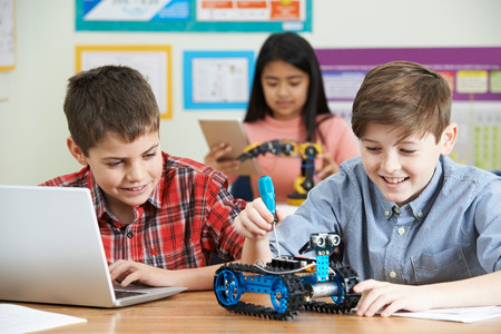 computer science: Pupils In Science Lesson Studying Robotics Stock Photo