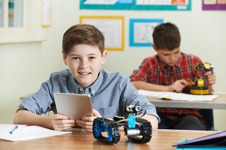Pupil Controlling Robot With Digital Tablet In Science Lesson