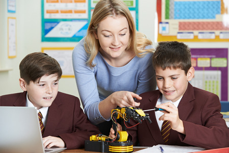Teacher With Pupils In Science Lesson Studying Robotics