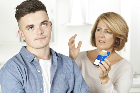 Mother Talking To Teenage Son About Dangers Of Smoking