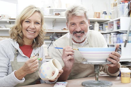 Mature Couple Enjoying Pottery Class Together