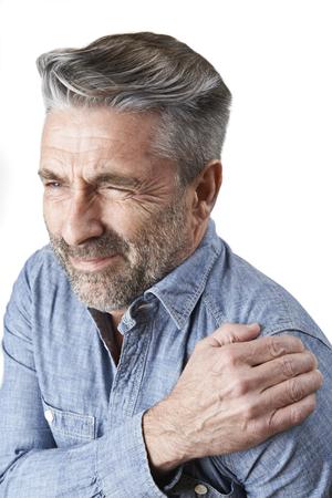Studio Shot Of Man Suffering With Frozen Shoulder 스톡 콘텐츠