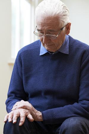 Senior Man Suffering With Parkinsons Diesease 版權商用圖片