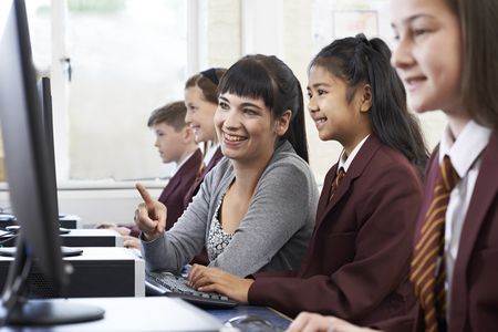 Pupils In Computer Class With Teacher