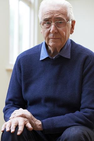 Senior Man Suffering With Parkinsons Diesease Stock Photo
