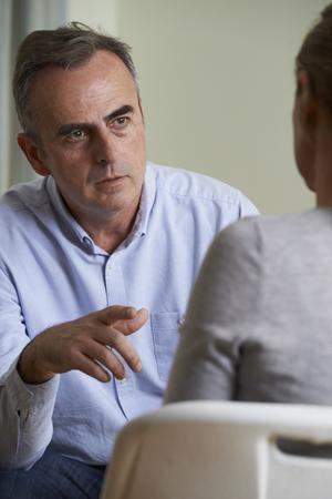 Depressed Mature Man Talking To Counsellor photo