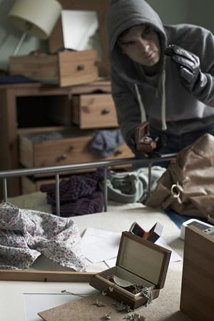 mess: Burglar Stealing Items From Bedroom During Hose Break In Stock Photo
