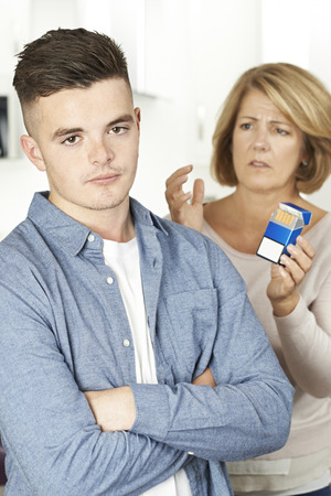 Mother Talking To Teenage Son About Dangers Of Smoking Stock Photo - 81120575