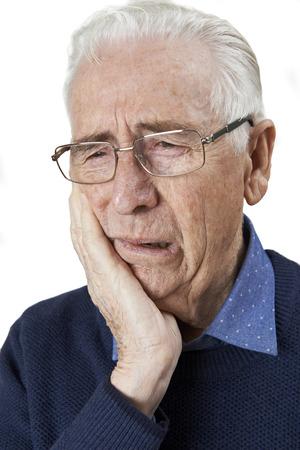 Studio Portrait Of Senior Man Suffering With Toothache