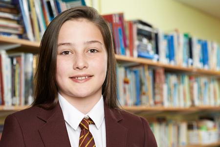 Portrait Of Girl Wearing School Uniform In Library