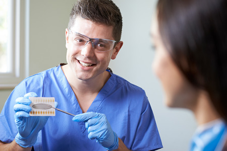 Dentist Giving Woman Advice On Cosmetic Teeth Whitening
