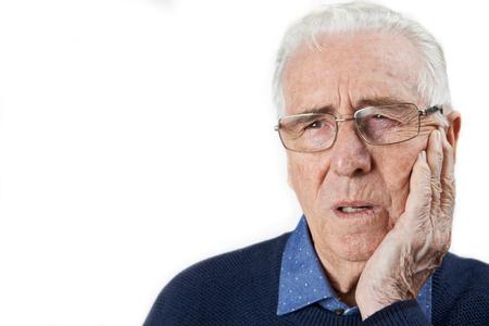 Studio Shot Of Senior Man Suffering With Toothache