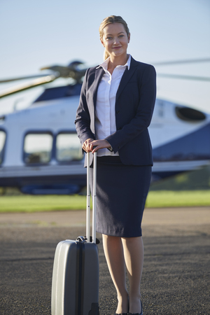 Portrait Of Businesswoman Standing In Front Of Helicopter  Banque d'images