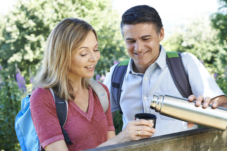 Mature Couple On Walk Drinking From Flask