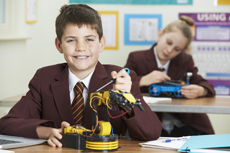 Portrait Of Male Pupil In Science Lesson Studying Robotics