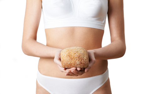 Close Up Of Woman Wearing Underwear Holding Bread Roll