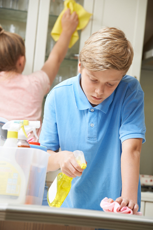 Children Helping With Household Chores And Cleaning Kitchen Stock fotó